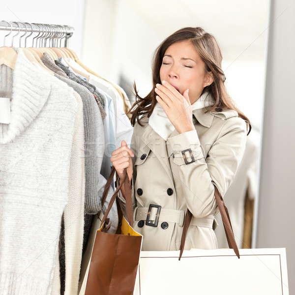 Fáradt nő ásít vásárlás ruházat ruházat Stock fotó © Ariwasabi