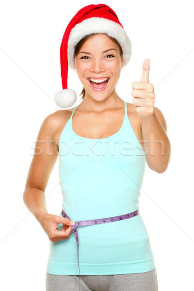 Stock photo: Christmas weight loss fitness concept
