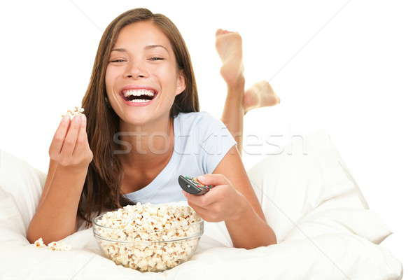 Woman watching funny movie laughing Stock photo © Ariwasabi