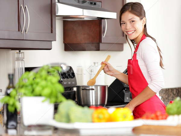 Cooking woman in kitchen Stock photo © Ariwasabi