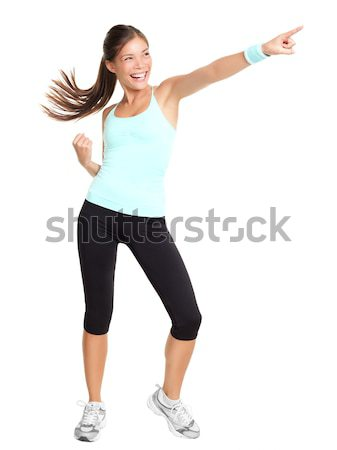 Aerobics fitness woman pointing Stock photo © Ariwasabi