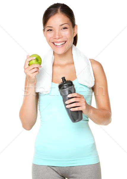 Photo stock: Femme · de · remise · en · forme · manger · pomme · souriant · heureux