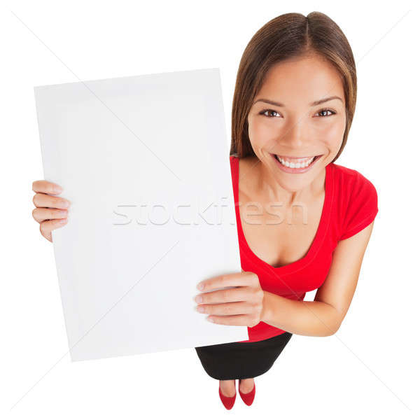 Stock photo: Sign woman holding up a blank white poster