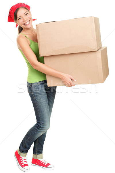 Woman carrying moving boxes Stock photo © Ariwasabi