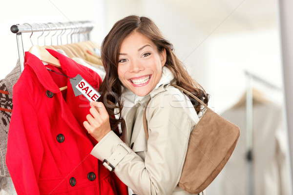 Shopping woman at clothes sale Stock photo © Ariwasabi