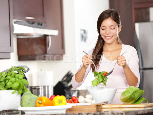 Woman making salad Stock photo © Ariwasabi