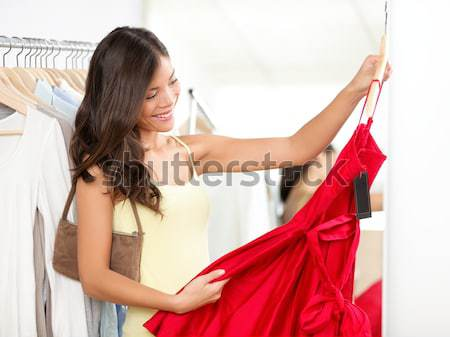 Girl trying dress Stock photo © Ariwasabi