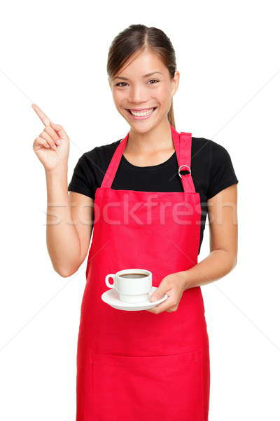 Stock photo: Waitress pointing holding coffee