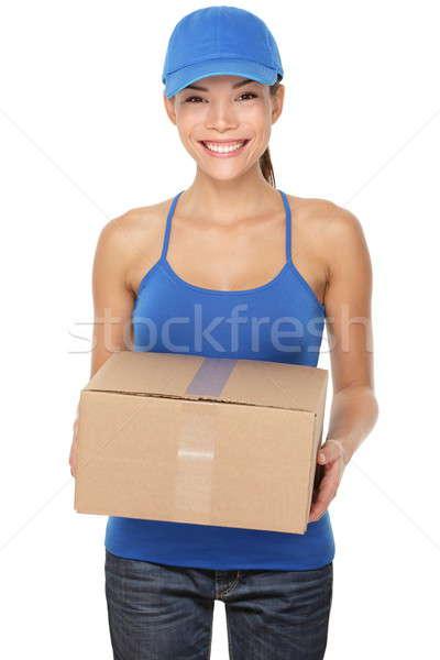 Livraison service postal femme paquet Photo stock © Ariwasabi
