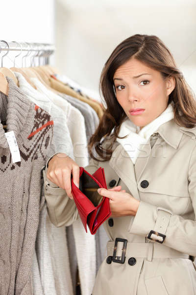 Woman shopper holding empty wallet or purse Stock photo © Ariwasabi