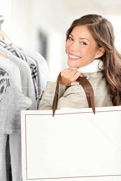 Stock fotó: Vásárló · nő · mutat · bevásárlószatyor · copy · space · mosolyog