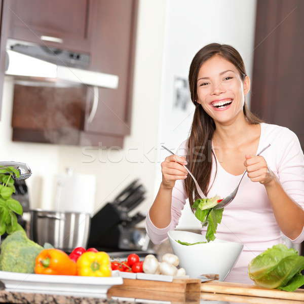 Stock photo: Woman making salad in kitchen