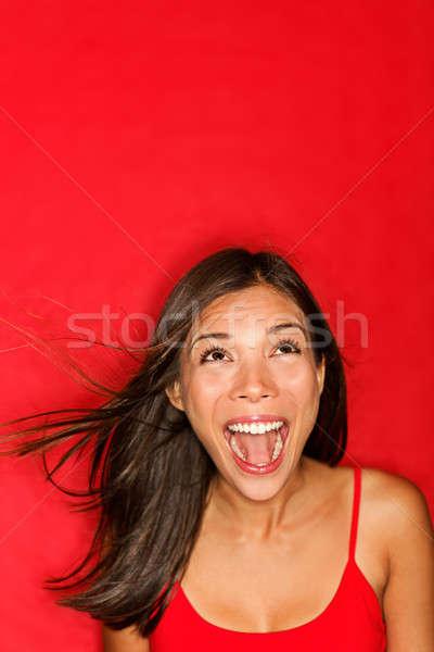 Surpreendido gritando mulher cópia espaço vermelho Foto stock © Ariwasabi