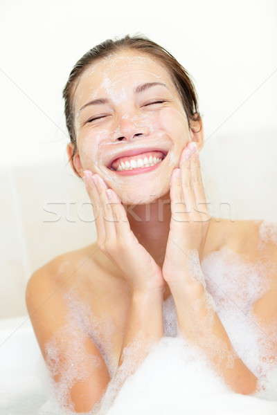 Stock photo: Woman washing face in bath