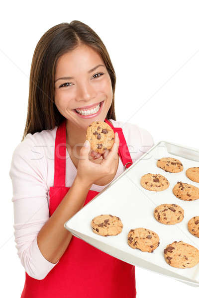 baking woman eating cookies happy Stock photo © Ariwasabi
