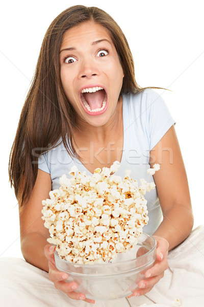 Woman scared funny watching movie Stock photo © Ariwasabi
