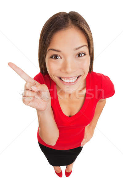 Stock photo: Grinning woman pointing to left of frame