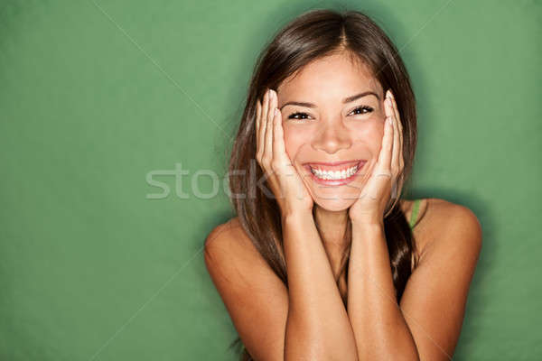 Surprised woman on green background. Stock photo © Ariwasabi