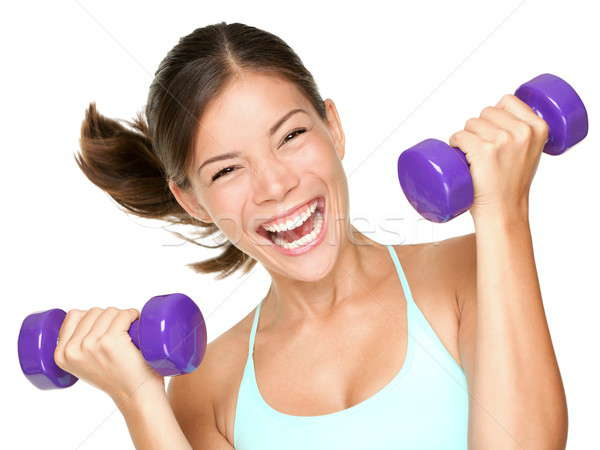 Happy fitness woman lifting dumbbells Stock photo © Ariwasabi