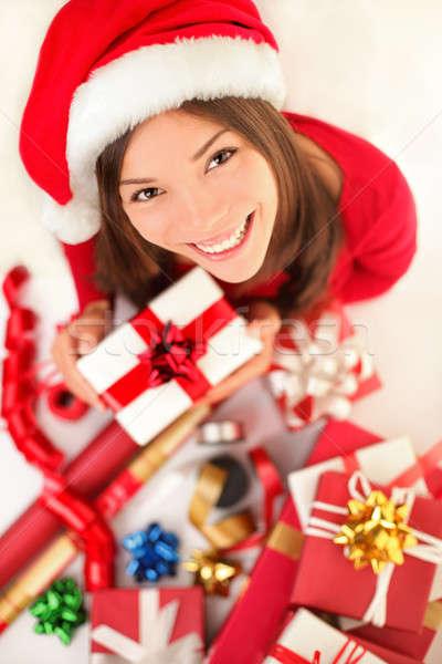Christmas gifts - woman wrapping christmas presents Stock photo © Ariwasabi
