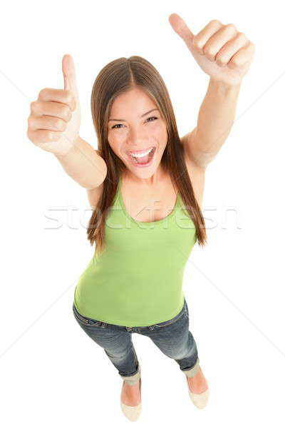 Stock photo: Happy woman giving thumbs up
