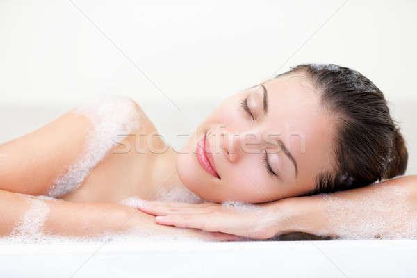 женщину расслабляющая ванны безмятежный улыбка Сток-фото © Ariwasabi