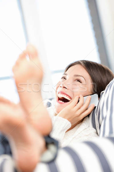 Stock photo: Woman talking and laughing on smart phone