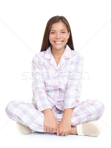 Uśmiechnięta kobieta posiedzenia piżama młoda kobieta cute Zdjęcia stock © Ariwasabi