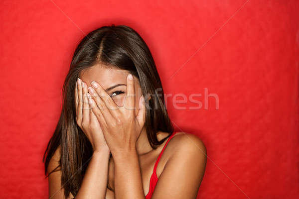 Playful shy woman hiding face laughing Stock photo © Ariwasabi