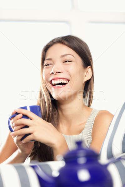 Woman laughing drinking tea Stock photo © Ariwasabi