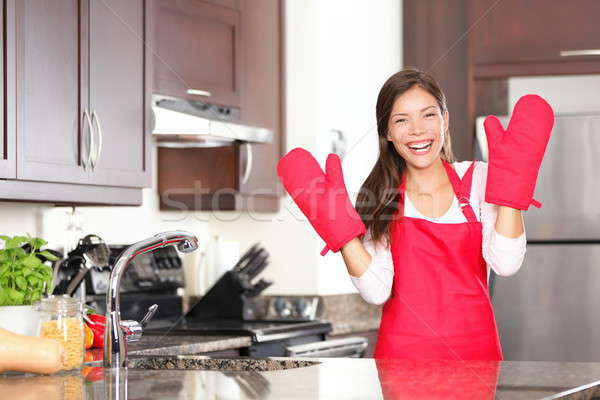 Happy baking cooking woman Stock photo © Ariwasabi