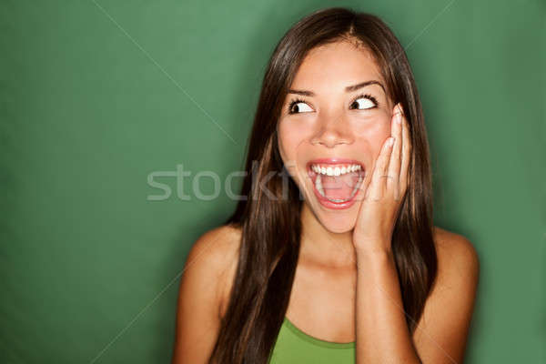amazement - woman excited looking to the side Stock photo © Ariwasabi