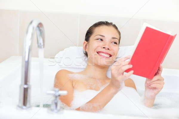 Woman reading book in bath Stock photo © Ariwasabi