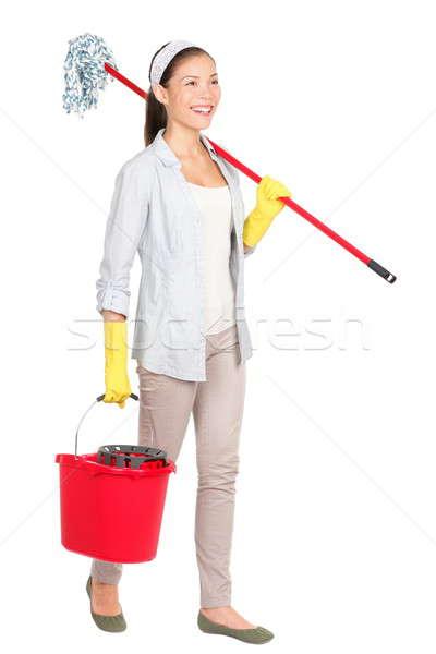 Donna delle pulizie secchio lavaggio piano piedi sorridere Foto d'archivio © Ariwasabi
