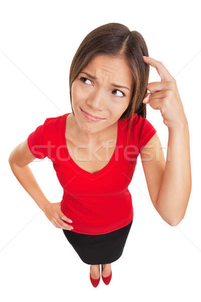 Stock photo: Confused woman scratching her head