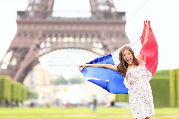 France - french flag woman by Eiffel tower, Paris Stock photo © Ariwasabi
