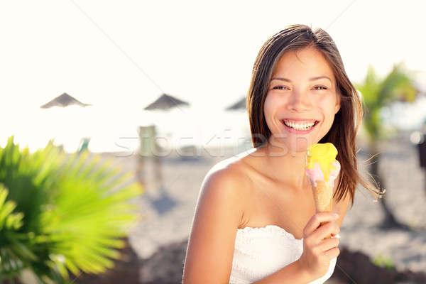 Stock photo: Woman eating ice cream