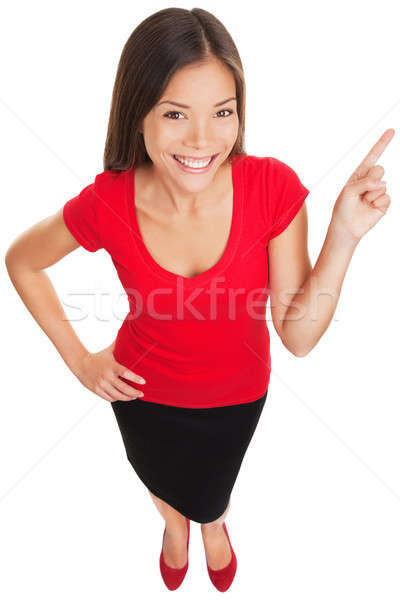 Pointing showing woman smiling cheerful Stock photo © Ariwasabi