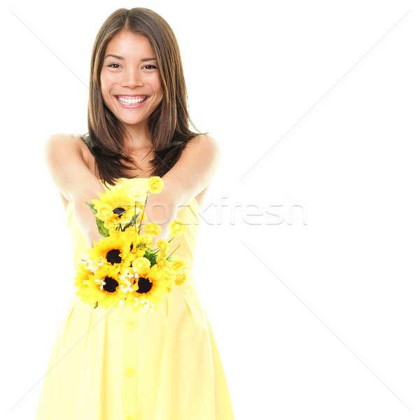 Stock fotó: Nő · mosolyog · mutat · virágok · sárga · virágok · izolált · fehér
