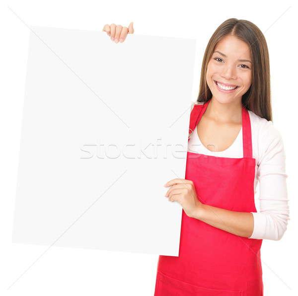 Sales clerk showing blank sign Stock photo © Ariwasabi