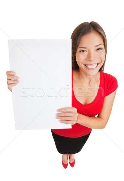Showing woman holding white blank sign placard Stock photo © Ariwasabi