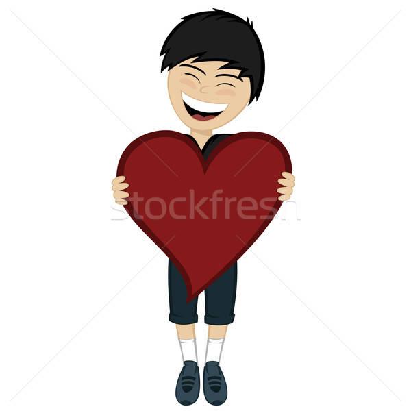Fiú meglepetés fekete nagy piros szív Stock fotó © arleevector