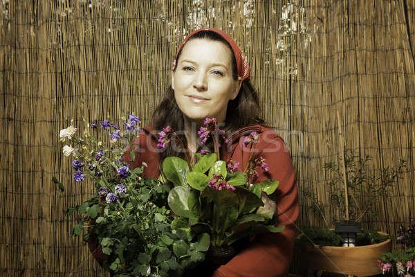 Woman holding flower pots Stock photo © armin_burkhardt