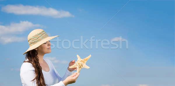 ストックフォト: 休暇 · 女性 · 青空 · ヒトデ
