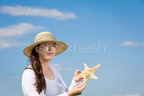 旅行 お土産 女性 青空 ヒトデ ストックフォト © armin_burkhardt