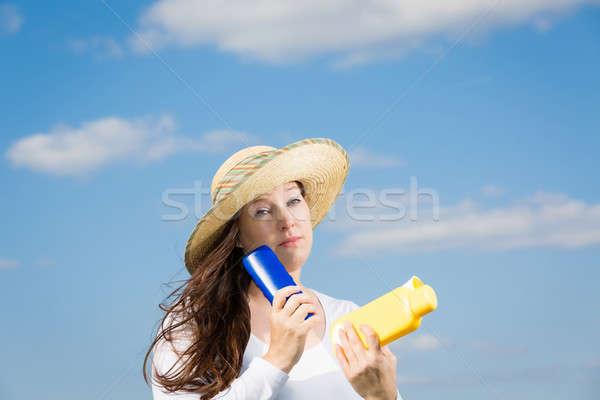 Protezione cancro della pelle donna cielo blu sole Foto d'archivio © armin_burkhardt