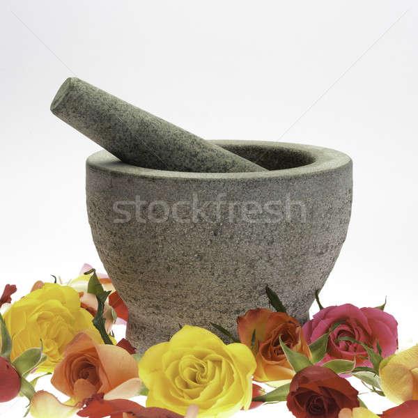 Mortar of stone in rose petals Stock photo © armin_burkhardt