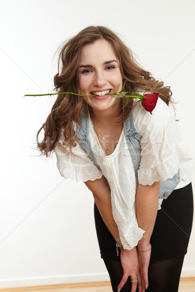 Girl with rose in mouth Stock photo © armstark