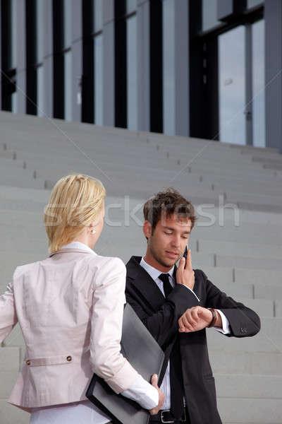 деловой человек глядя часы человека счастливым Сток-фото © armstark