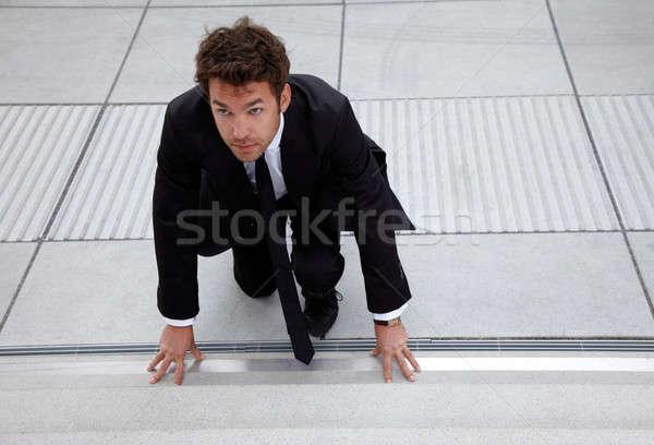 Genç iş adamı başlatmak pozisyon merdiven iş Stok fotoğraf © armstark